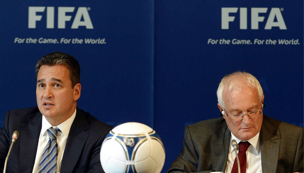 FILE - In this Friday, July 27, 2012 file photo, Chairmen of the two chambers of the new FIFA Ethics Committee Michael Garcia, left, from the US and Joachim Eckert, right, from Germany attend a press conference, at the Home of FIFA in Zurich, Switzerland. FIFA ethics judge Joachim Eckert is unlikely to reach final decisions in the 2018 and 2022 World Cup bidding corruption probe until early next year. FIFA has cleared Russia and Qatar of any wrongdoing in their winning bids for the next two World Cups. German judge Joachim Eckert formally closed FIFA's probe into the 2018 and 2022 World Cup bidding contests on Thursday, almost four years after the vote by the governing body's scandal-tainted executive committee. Eckert noted wrongdoing among the 11 bidding nations in a 42-page summary of FIFA prosecutor Michael Garcia's investigations. (AP Photo/Keystone, Walter Bieri, File)