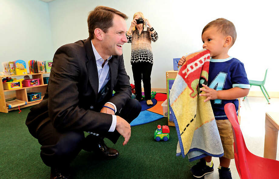 Hour photo / Erik TrautmannIn this file photo, US Congressman Jim Himes meets with Joshua Juarez as he tours the Head Start program at Nathaniel Ely Elementary School to discuss his advocacy for Head Start and early education programs Friday morning.