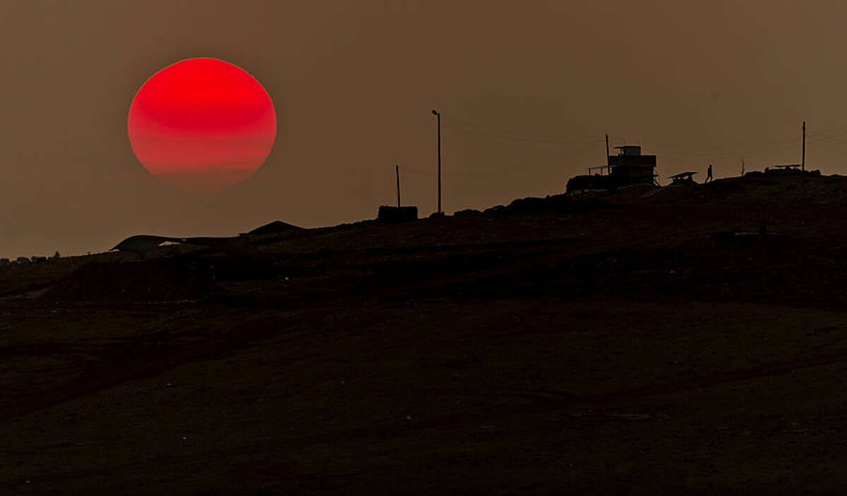 A soldier walks at a Turkish military outpost overlooking the Syrian city of Kobani, on a hilltop outside Suruc, on the Turkey-Syria border Monday, Nov. 17, 2014. Kobani, also known as Ayn Arab, and its surrounding areas, has been under assault by extremists of the Islamic State group since mid-September and is being defended by Kurdish fighters. (AP Photo/Vadim Ghirda)