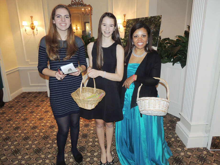 Contributed photoVolunteers with baskets selling bracelets (left to right)  Claire Kostohryz of Brien McMahon High School, Isabel Thelen of Wilton High School and Sandy Hatschl of Norwalk Community College.
