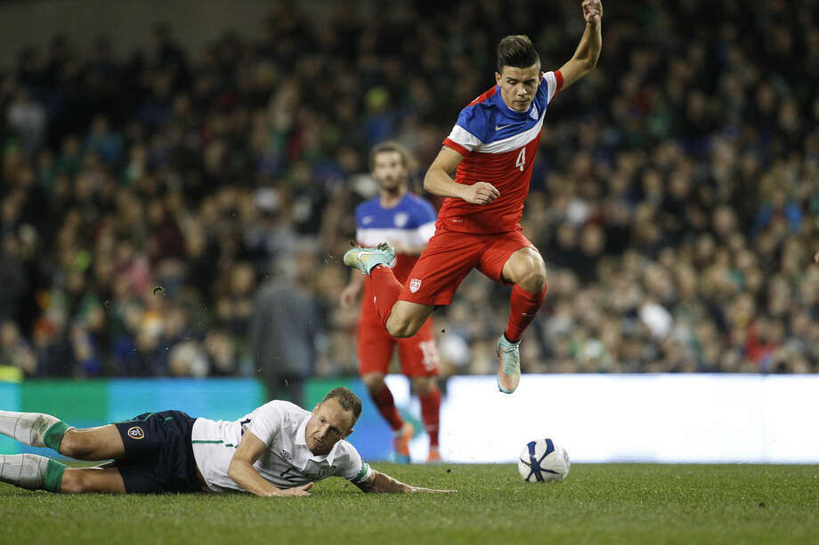 United States' Alfredo Morales, right, wins the ball from Republic of Ireland's David Meyler during the international friendly soccer match between the at the Aviva stadium, Dublin, Ireland, Tuesday, Nov. 18, 2014. (AP Photo/Peter Morrison)