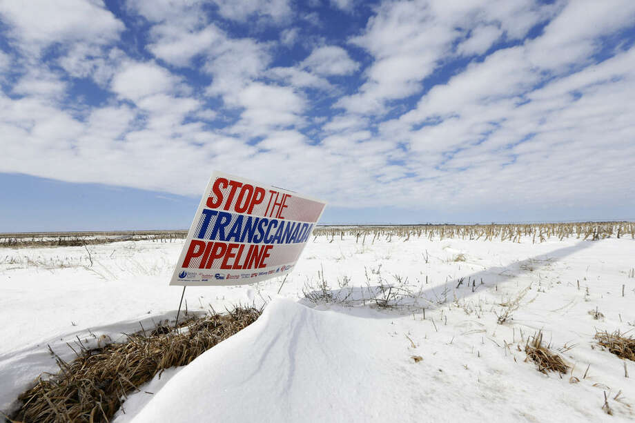 "FILE - In this March 11, 2013 file photo, a sign reading ""Stop the Transcanada Pipeline"" stands in a field near Bradshaw, Neb., along the Keystone XL pipeline route through the state. With the clock ticking, supporters of a Senate bill to approve the Keystone XL pipeline are still scrambling to find the last vote. (AP Photo/Nati Harnik, File)"