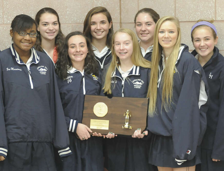 Hour photo/John NashEight Norwalk residents were part of Lauralton Hall's Class M state swim championship this past season. They include, front row, from left, Zoe Merriman, Ashley Evens, Emma Lenskold, Dakota Meyer, and Lauren Buttling; and back row, from left, captain Marissa Favano, Shannon Buttling, and Caroline Favano. Dakota Meyer and Shannon Buttling were All-State swimmers.