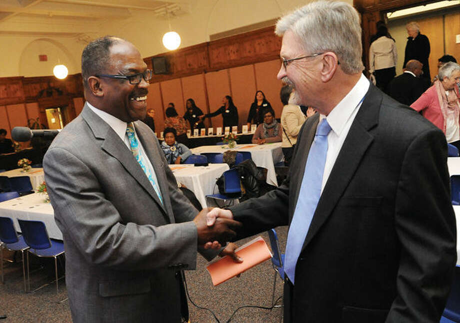 Rev. Albert Dancy with Tod Bryant, President & Co-Founder of the Norwalk Historic Preservation Trust Tuesday at the Norwalk City Hall Community Room. The Macedonia Church hosted the 39 West Avenue Historic Preservation and Thanksgiving Dinner with a silent auction to raise money for restoration of the church. Hour photo/Matthew Vinci
