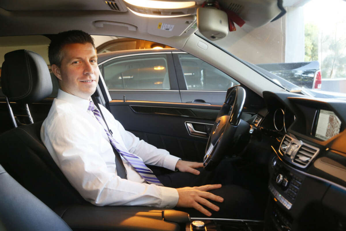 In this Monday, Nov. 18, 2014 photo, University of Southern California professor Jeffery Miller sits in his car in Los Angeles. Miller develops software that will help the cars of the future drive themselves. (AP Photo/Nick Ut)