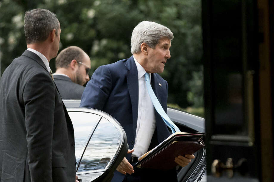 U.S. Secretary of State John Kerry arrives for his meeting with Oman Foreign Minister Yusuf Bin Alawi bin Abdullah at the official residence of the U.S. ambassador to Britain, Winfield House, in London, Tuesday, Nov. 18, 2014. (AP Photo/Matt Dunham)