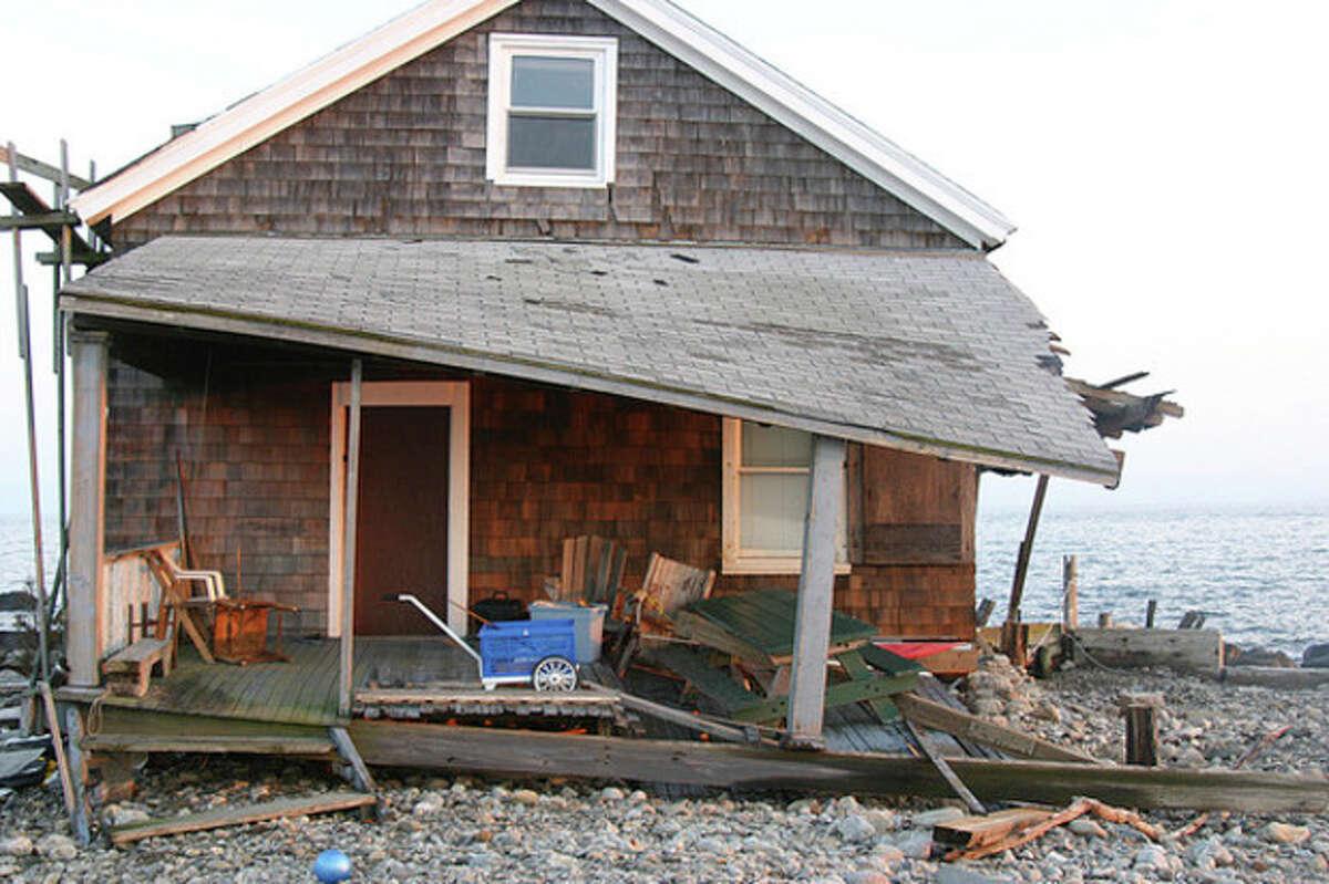 Hour photo / Chris Bosak A structure on Sheffield Island was heavily damaged by Hurricane Sandy.