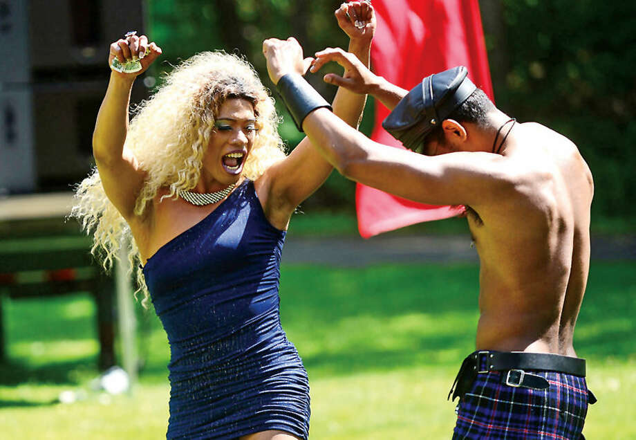 Hour photo / Erik Trautmann Drag Queen Lucia Virginity dances with audience at The Pride in the Park event at Mathews Park Saturday. The event was organized by the Triangle Community Center, and sponsored by General Electric, TD Bank, World Health Clinicians, the Mid-Fairfield AIDS Project, and Prudential.