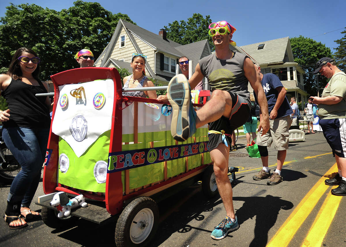 Joe Crupi, of Stamford, warms up with some high kicks as he prepares to race with his team Black Rock Mini Bus in the Bed Race, part of Black Rock Day events on Brewster Street in the Black Rock section of Bridgeport, Conn. on Sunday, June 12, 2016.