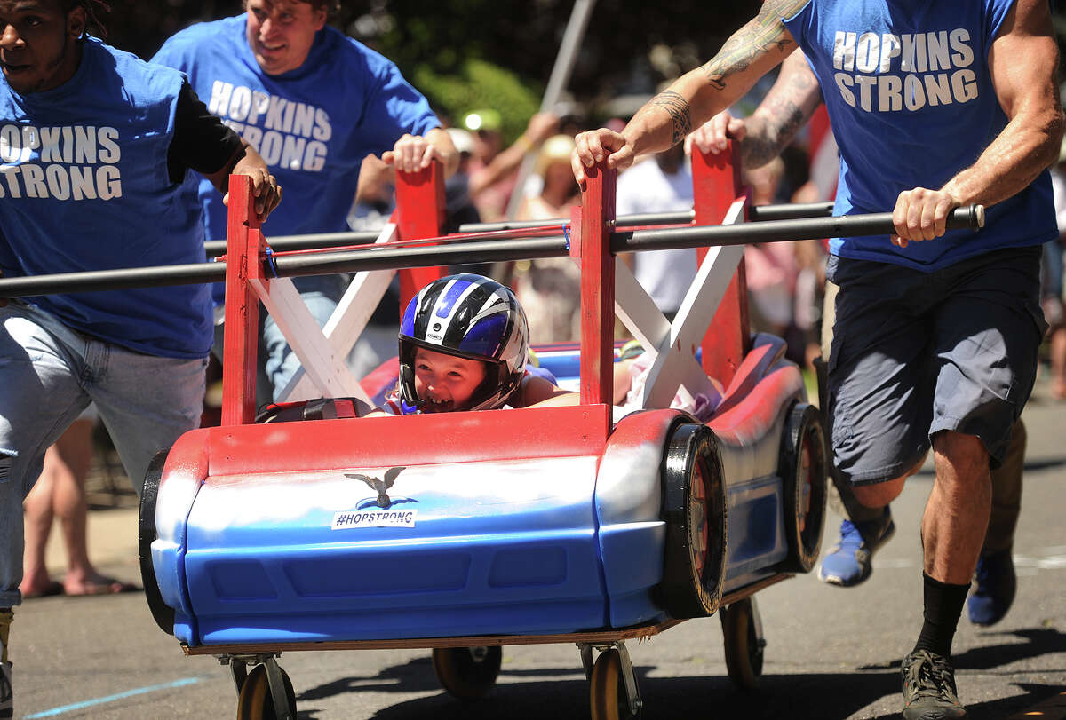 Cassidy D'Andrea, 7, of Bridgeport, pilot the Hopkins Strong entry in the Bed Race, part of Black Rock Day events on Brewster Street in the Black Rock section of Bridgeport, Conn. on Sunday, June 12, 2016. Hopkins Strong raises funds in support of Bridgeport resident and Metro North employee Brian Hopkins, who suffered multiples third degree burns while on the job.