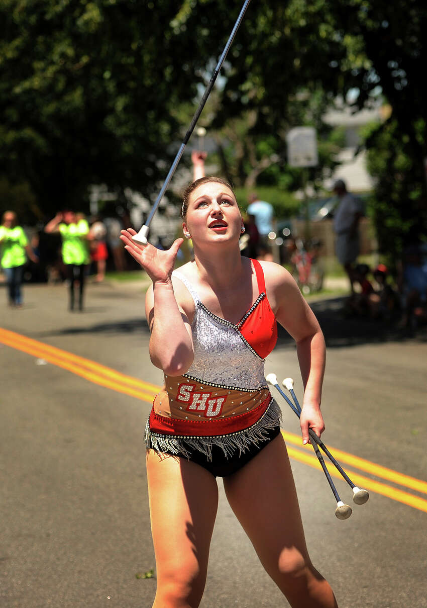 Sacred Heart University baton twirler Emma Convey performs in the Black Rock Day Best Small Parade in America on Harborview Avenue in the Black Rock section of Bridgeport, Conn. on Sunday, June 12, 2016.