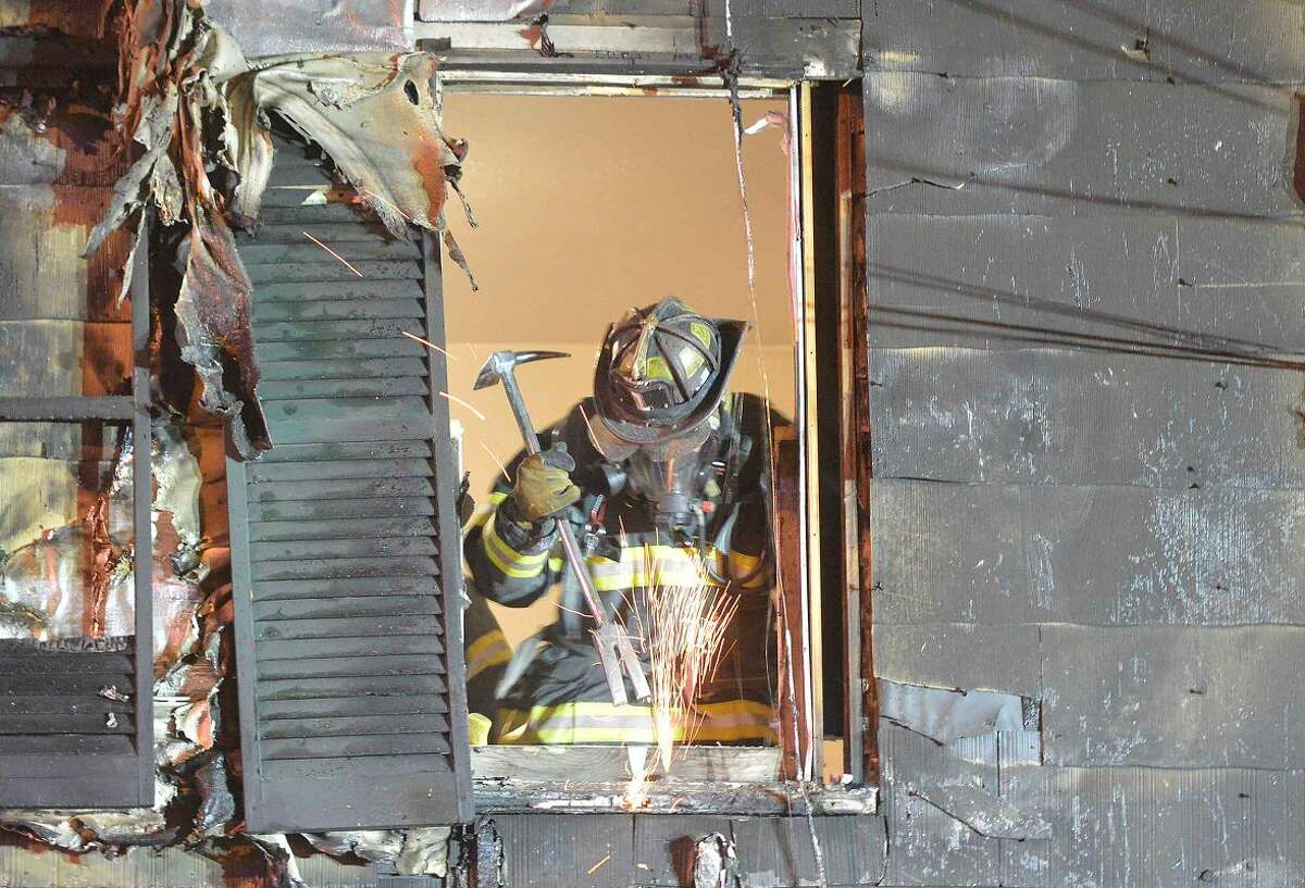 Hour Photo/Alex von Kleydorff Firefighters respond to a house fire on Bouton Street at 6pm on Wednesday night