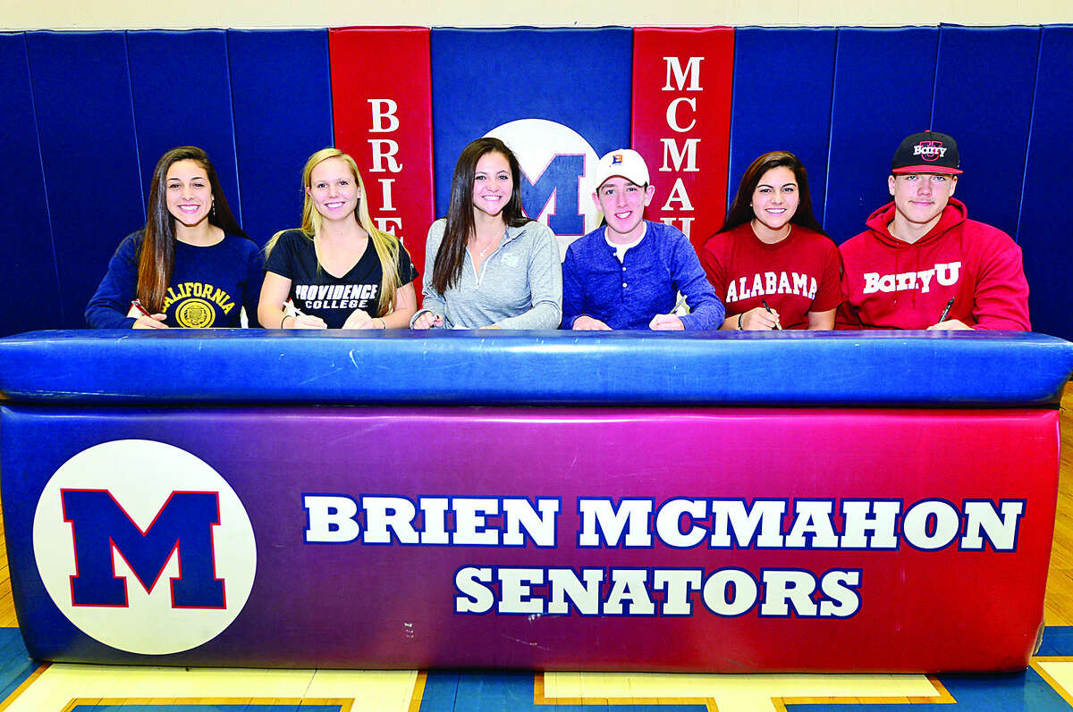 Hour photo / Erik Trautmann Olivia Clark, Paige DeLago, Amelia Ornato, Connor O'Brien, Gillain Castro and Paul Salata sign their National Letters of Intent to attend University of California, Providence College, Stetson University, Bucknell University, University of Alabama and Barry University respectively.