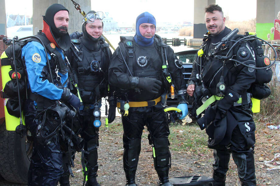 Hour photo/Chris Bosak Norwalk and Darien police combined for a diving training session held in the frigid waters of the Norwalk River on Thursday morning. The divers included, (l to r): Bruce Lovallo of Norwalk; Jim Martin of Darien; Dan Ehret of Darien; and Mike Sellas of Norwalk.