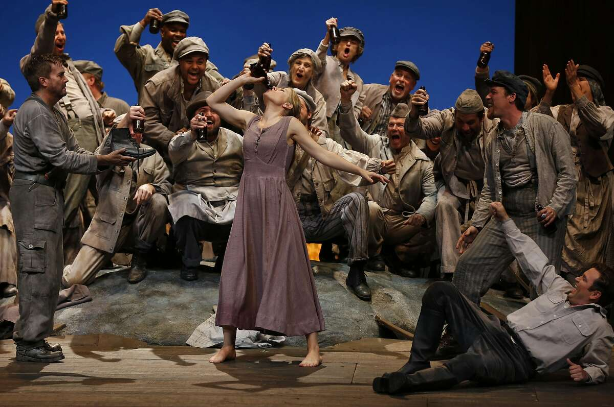 Malin Bystrom performs as Jenufa, center, with Scott Quinn as Steva Buryja, right, during a dress rehearsal of Jenufa at the San Francisco Opera, War Memorial and Performing Arts Center June 11, 2016 in San Francisco, Calif.