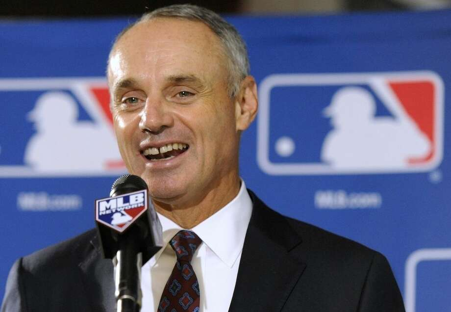 FILE - In this Aug. 14, 2014, file phhoto, Major League Baseball Chief Operating Officer Rob Manfred speaks to reporters after team owners elected him as the next commissioner of Major League Baseball in Baltimore. Baseball owners voted Thursday, Nov. 20, 2014, to give him a five-year term as commissioner when he succeeds Bud Selig in two months. (AP Photo/Steve Ruark, File)