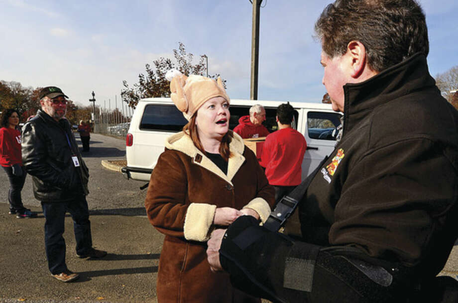 Hour photo / Erik Trautmann Recipient Jesse McGarty thanks Stew Leonard Jr. after receiving her frozen turkeys for the East Ave United Methodist Church during Stew Leonard's 35th Annual Turkey Brigade Thursday. Styew Leonard's stores gave out more than 1,900 turkeys to more than 100 churches, civic groups, elderly housing and senior nutrition programs, and schools the Norwalk, Newington and Danbury, Connecticut and Yonkers, New York communities to help provide Thanksgiving day meals for families in need.