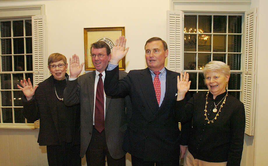 Selectman Hal Clark (second from right) is sworn in during a ceremony at Old Town Hall alongside Marilyn Gould, Richard Creeth and Alice Ayers on Dec. 2, 2005.