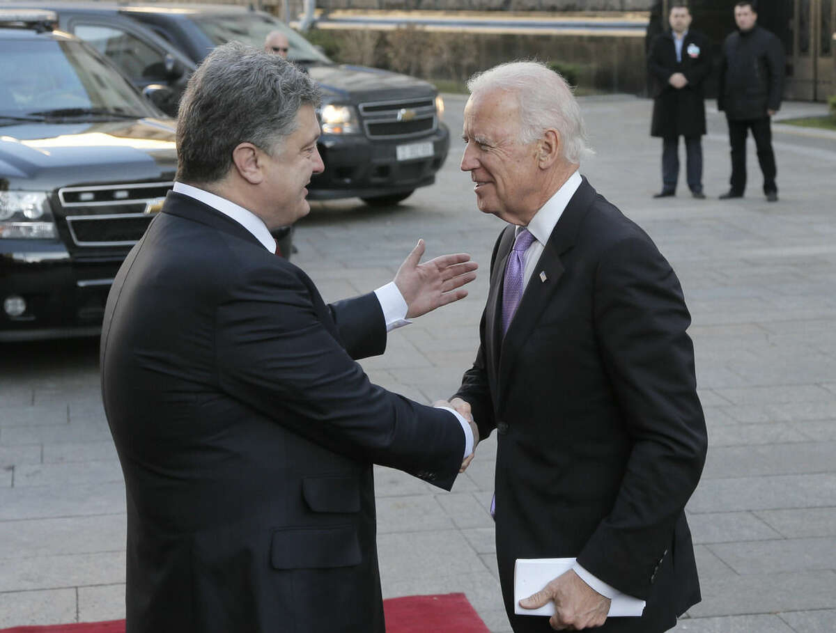 Ukrainian President Petro Poroshenko, left, shakes hands with U.S. Vice President Joe Biden during a meeting in Kiev, Ukraine, Friday, Nov. 21, 2014. Biden is also visiting Turkey and is the latest in a stream of U.S. officials who have traveled to Turkey to urge Ankara to step up its role in fighting Islamic State militants in neighboring Syria. (AP Photo/Efrem Lukatsky)