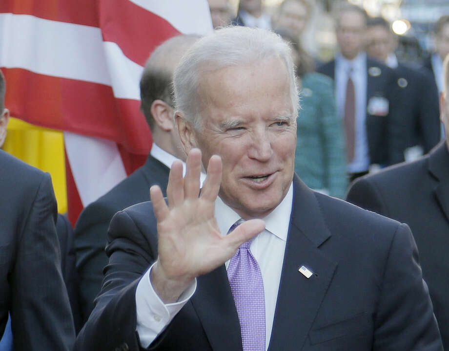 U.S. Vice President Joe Biden smiles for the cameras during a visit in Kiev, Ukraine, Friday, Nov. 21, 2014. Biden is also visiting Turkey and is the latest in a stream of U.S. officials who have traveled to Turkey to urge Ankara to step up its role in fighting Islamic State militants in neighboring Syria. (AP Photo/Efrem Lukatsky)