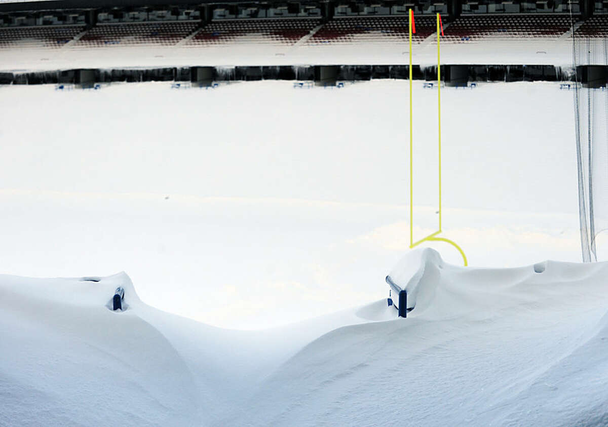An aisle is drifted over and seats are filled with snow at Ralph Wilson Stadium in Orchard Park, N.Y. Friday, Nov. 21, 2014. Snowed out in Buffalo, the Bills are heading to Detroit to play their