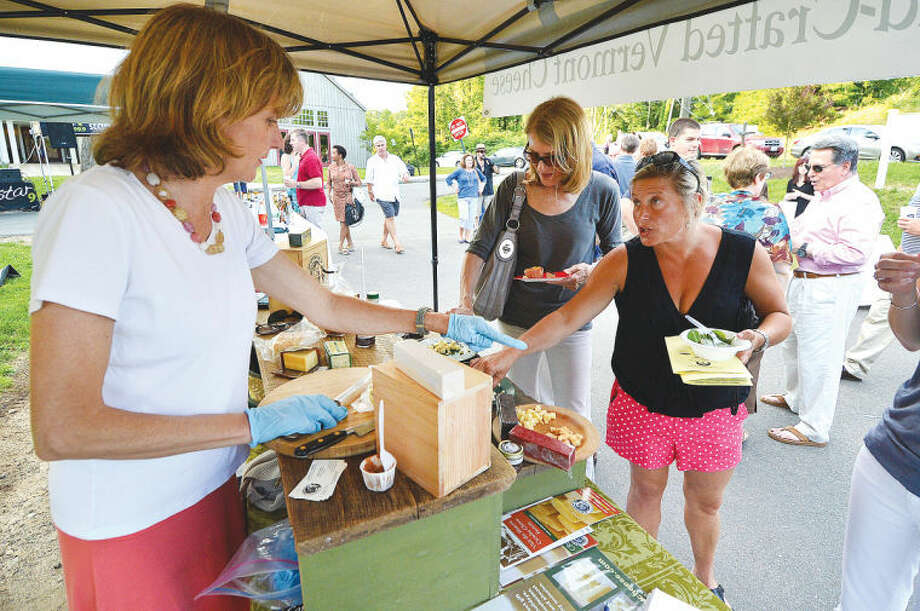 Jill Jones, owner of Crowley Cheese in Vermont, is busy keeping samples of her Hand Made cheeses ready at Taste of Wilton.