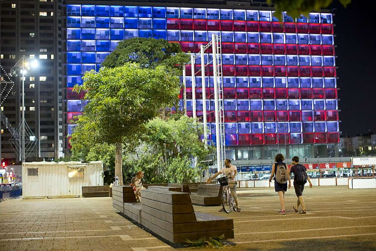 Tel-Aviv city hall lit up with the U.S. flag colors in solidarity with Florida's shooting attack victims, in Tel Aviv, Israel, Sunday, June 12, 2016. The shooting attack in Orlando, Florida, USA, Sunday, left more than 50 people dead amid a multitude of events celebrating LGBT Pride Month. (AP Photo/Oded Balilty)