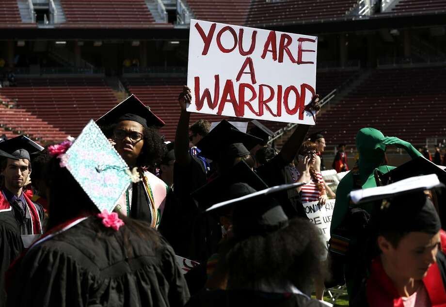 A graduate holds a sign supporting victims of sexual assault before the Stanford University Commencement in Stanford Stadium in Stanford, California, on Sunday, June 12, 2016. Photo: Connor Radnovich, The Chronicle