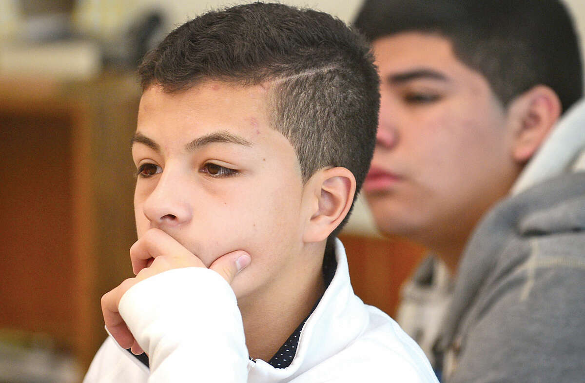 Hour photo / Erik Trautmann Ponus Ridge Middle School 8th grader Bryant Mejia listens to a representative from Priceline during the school's 1st annual Career Day Thursday.