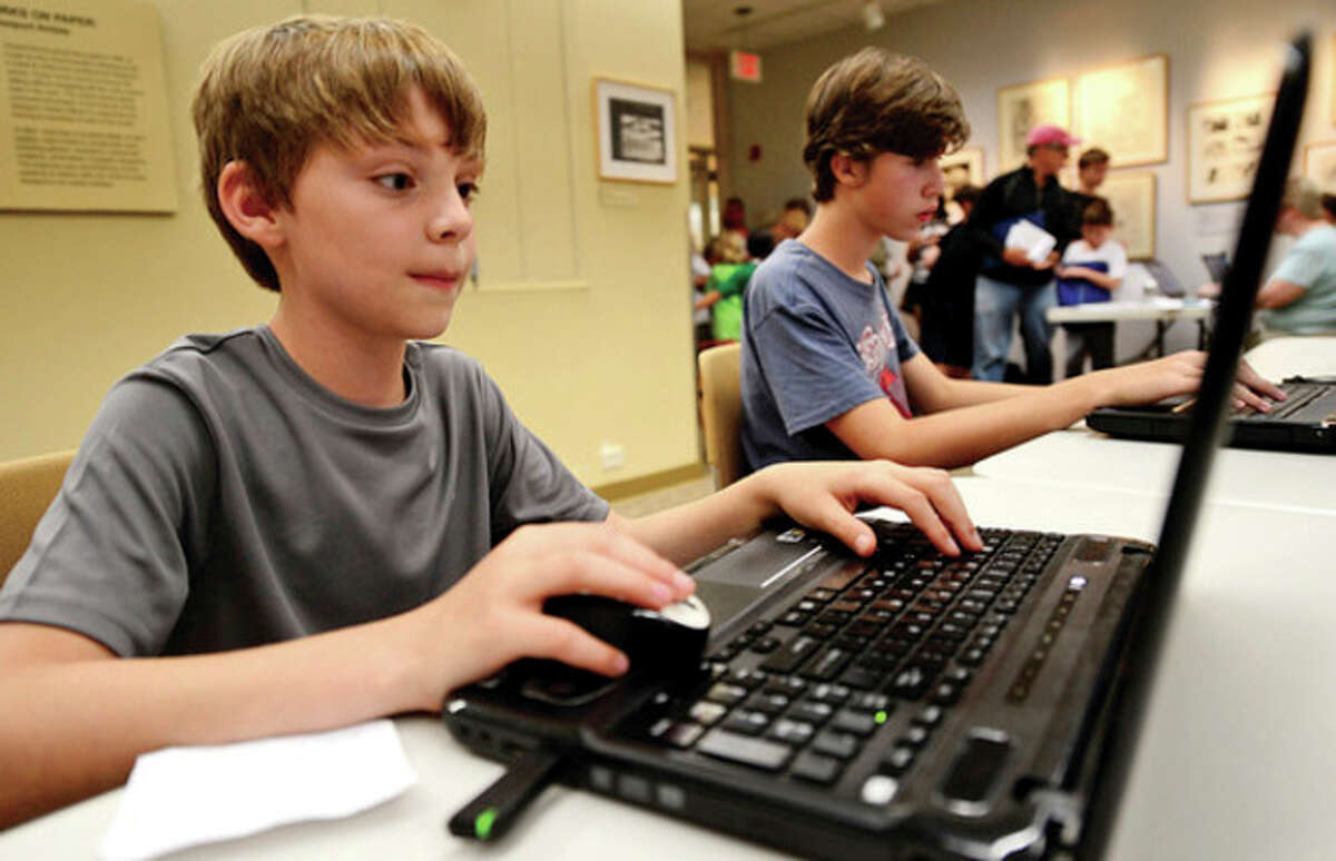 Hour photos / Erik Trautmann Shane Selinger plays Minecraft at the Westport Public Library's Minecraft Day, where teens connect to a countywide server to play the popular game Saturday.