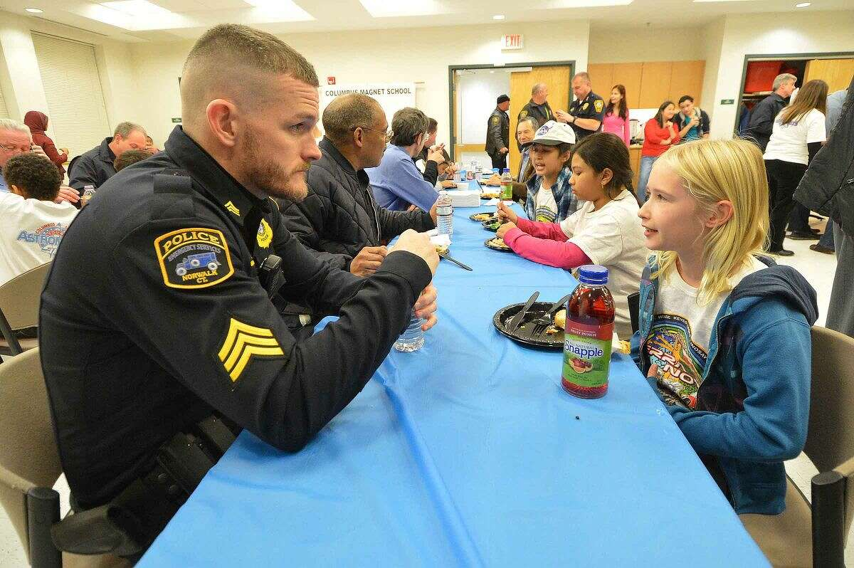 Hour Photo/Alex von Kleydorff Columbus Magnet School Young Astronauts serve up a feast for the city's First responders at Norwalk Police Headquarters