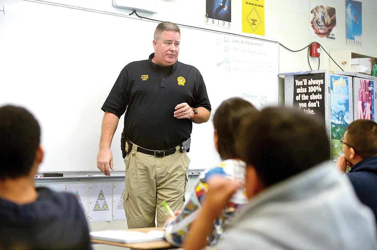 Hour photo / Erik Trautmann Norwalk police lieutenent Art Weisgerburger talks to 8th graders about his job as a Crime Scene Investigator during Ponus Ridge Middle Schoo's 1st annual Career Day Thursday.
