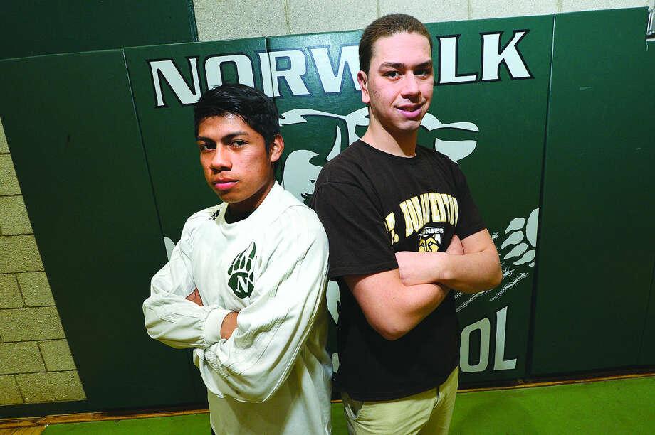 Hour Photo/Alex von Kleydorff Jose Canahui and Eddie Donovan sign for college athletics