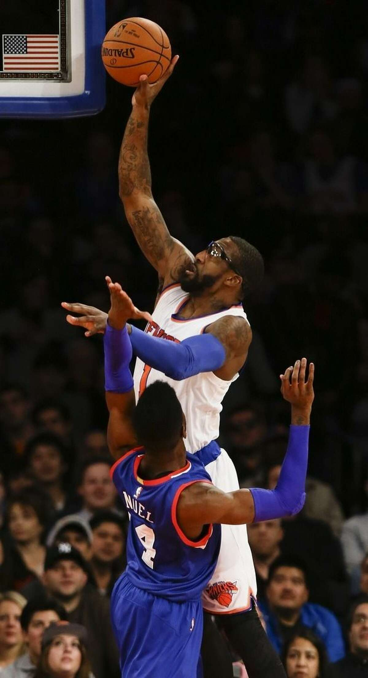 New York Knicks' Amare Stoudemire (1) shoots over Philadelphia 76ers' Nerlens Noel (4) during the first half of an NBA basketball game Saturday, Nov. 22, 2014, in New York. (AP Photo/Frank Franklin II)