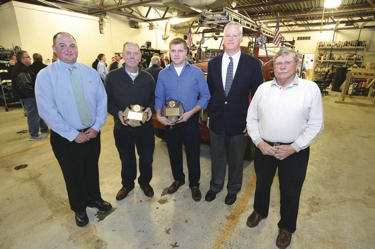 Hour photo/Alex von Kleydorff Principles attending the 112th annual dinner of Rowayton Hose Company No. 1, from left, are Chief Todd R. DeKlyn, former Chief Edwin C. Carlson, Firefighter-of-the-Year Jake Raymond, Assistant Chief Dan Oak and Hose Company President Jack B. Raymond.