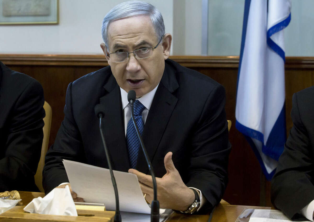 Israeli Prime Minister Benjamin Netanyahu speaks during in his Cabinet meeting in his office in Jerusalem on Sunday, Nov. 23, 2014. At the start of the meeting, Netanyahu called for a bill that would revoke residency rights for Palestinians involved in attacks against Israelis. (AP Photo/Jim Hollander, Pool)