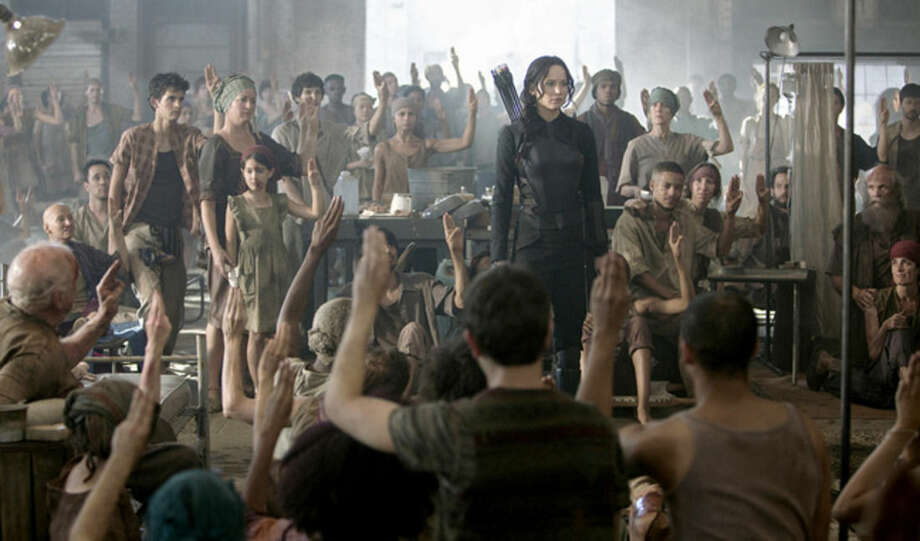 "Murray Close/LionsgateJennifer Lawrence as Katniss Everdeen in a scene from ""The Hunger Games: Mockingjay Part 1."""