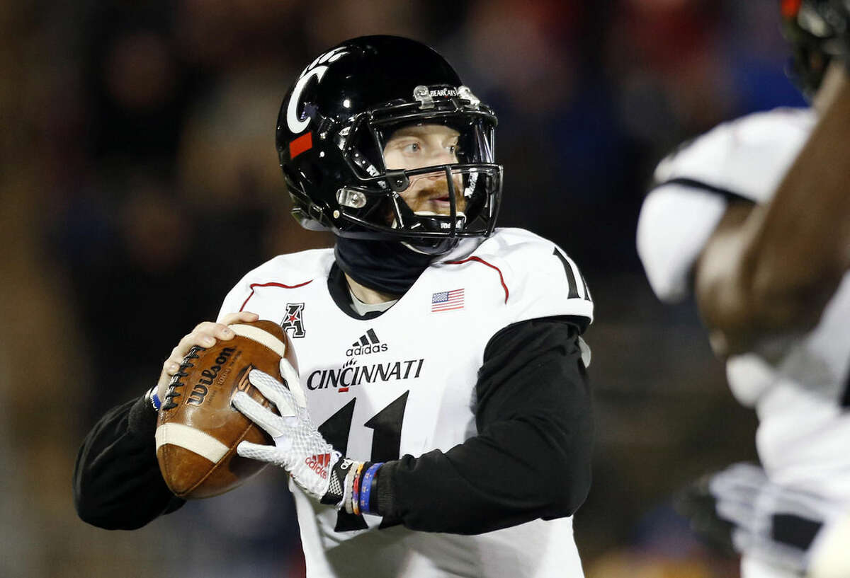 Cincinnati quarterback Gunner Kiel looks to pass in the first half of an NCAA college football game against Connecticut in East Hartford, Conn., Saturday, Nov. 22, 2014. (AP Photo/Michael Dwyer)