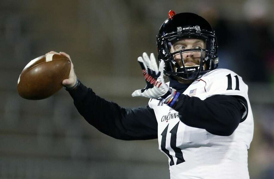 Cincinnati quarterback Gunner Kiel (11) warms up before an NCAA college football game against Connecticut in East Hartford, Conn., Saturday, Nov. 22, 2014. (AP Photo/Michael Dwyer)