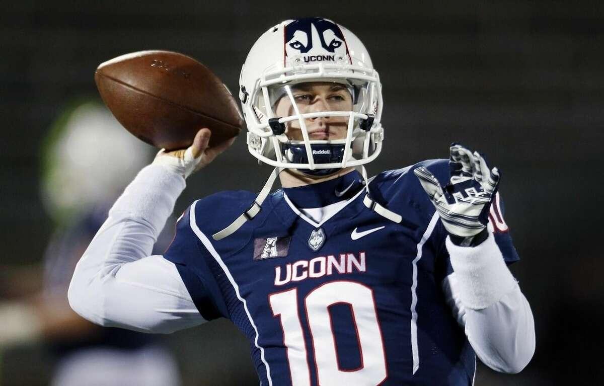 Connecticut quarterback Chandler Whitmer warms up before an NCAA college football game against Cincinnati in East Hartford, Conn., Saturday, Nov. 22, 2014. (AP Photo/Michael Dwyer)