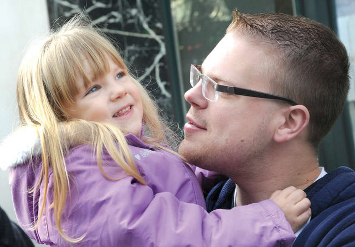 Brandon Stowe with his daughter Savanah 4 enjoy the annual UBS Parade Spectacular in downtown Stamford on Sunday. Hour photo/Matthew Vinci