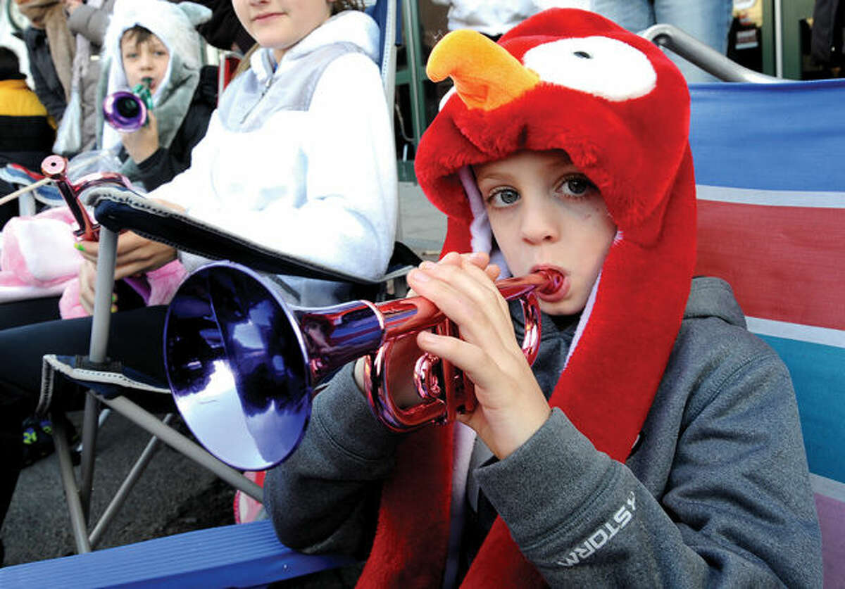 7 year old Jake Ferrare front row to the annual UBS Parade Spectacular in downtown Stamford on Sunday. Hour photo/Matthew Vinci