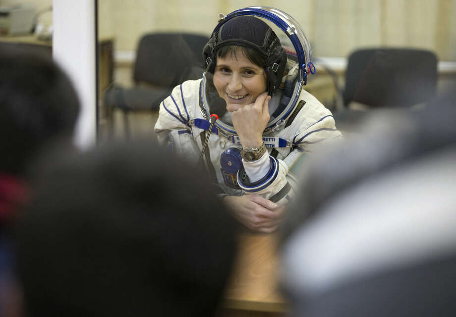 Italian astronaut Samantha Cristoforetti, crew member of the mission to the International Space Station, ISS, speaks with her relatives prior to the launch of Soyuz-FG rocket at the Russian leased Baikonur cosmodrome, Kazakhstan, Sunday, Nov. 23, 2014. (AP Photo/Dmitry Lovetsky, Pool)