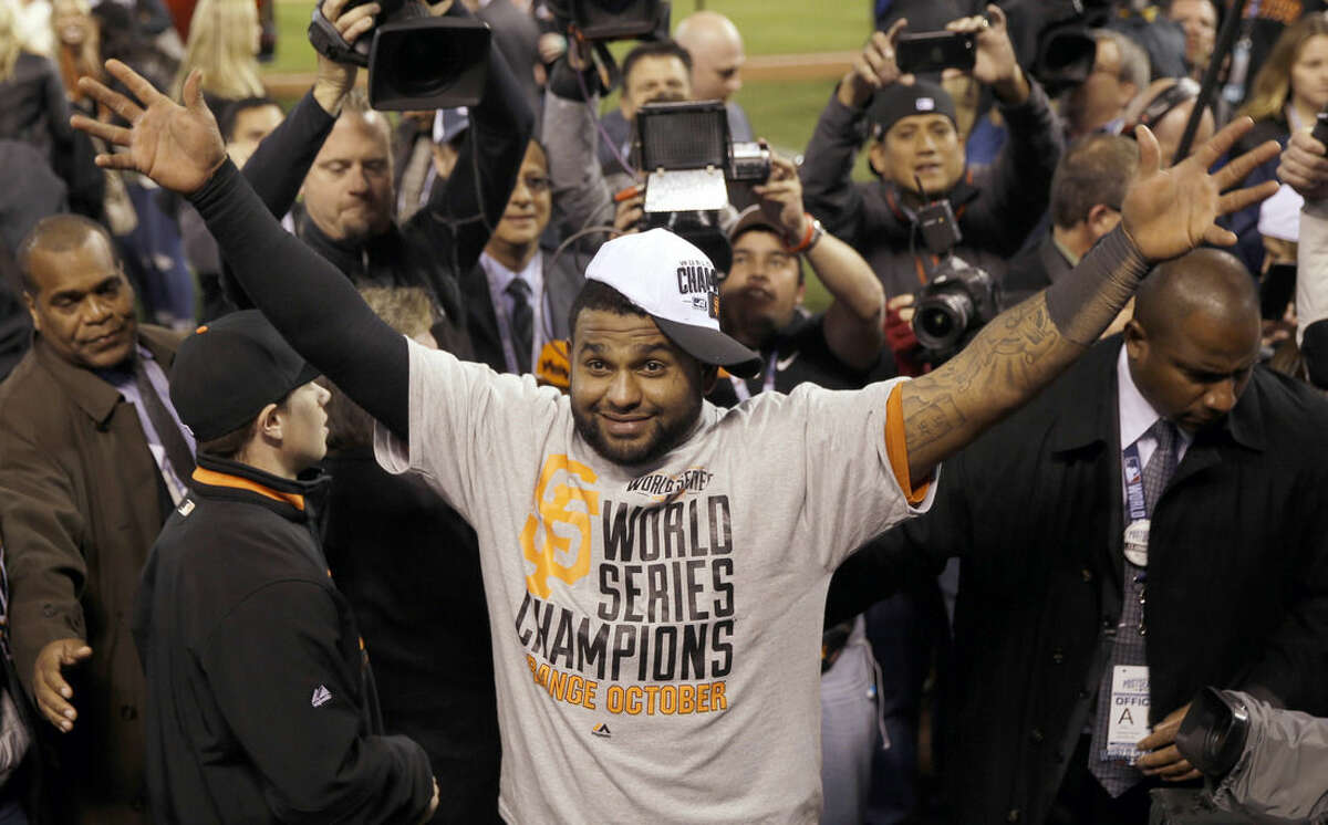 FILE - In this Oct. 29, 2014, file photo, San Francisco Giants' Pablo Sandoval celebrates after Game 7 of baseball's World Series against the Kansas City Royals in Kansas City, Mo. The Giants won 3-2 to win the series. Giants assistant general manager Bobby Evans says he has been given