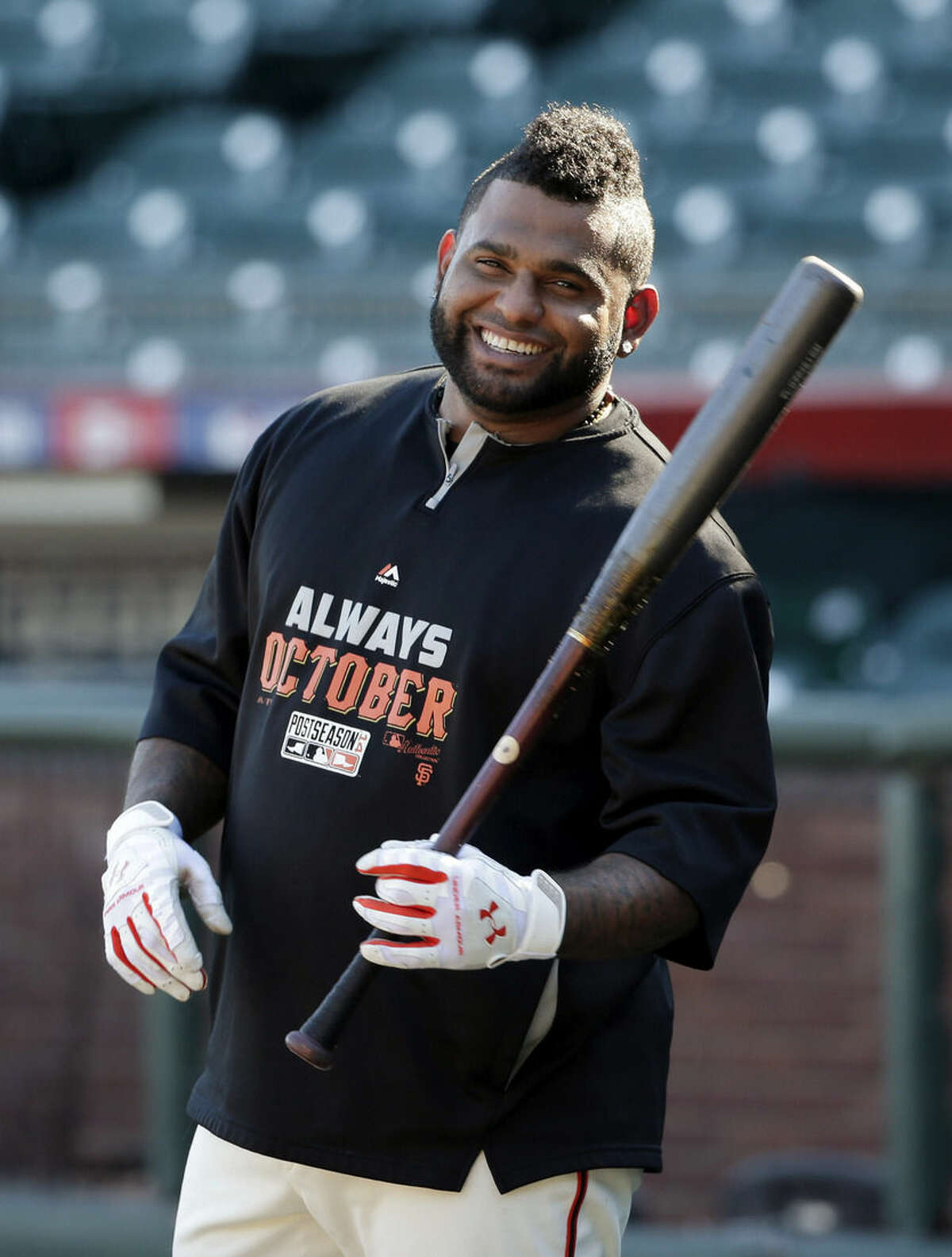 FILE - In this Oct. 18, 2014, file photo, San Francisco Giants third baseman Pablo Sandoval smiles as he takes batting practice during a baseball workout in San Francisco. Giants assistant general manager Bobby Evans says he has been given