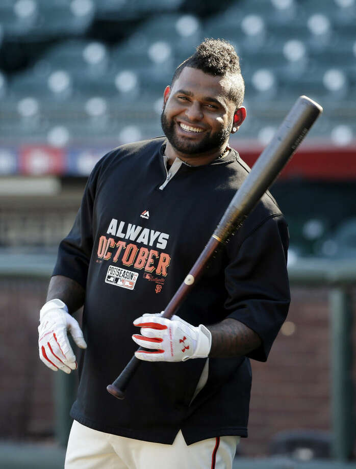 """FILE - In this Oct. 18, 2014, file photo, San Francisco Giants third baseman Pablo Sandoval smiles as he takes batting practice during a baseball workout in San Francisco. Giants assistant general manager Bobby Evans says he has been given """"every indication"""" the free agent third baseman will give careful consideration to re-signing with the World Series champions. (AP Photo/Marcio Jose Sanchez)"""