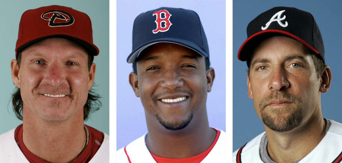 From left are Arizona Diamondbacks' Randy Johnson in 2008, Boston Red Sox' Pedro Martinez in 2003 and Atlanta Braves' John Smoltz in 2008. Johnson, Martinez and Smoltz are among 17 newcomers on baseball's 2015 Hall of Fame ballot, announced Monday, Nov. 24, 2014. (AP Photo/File)