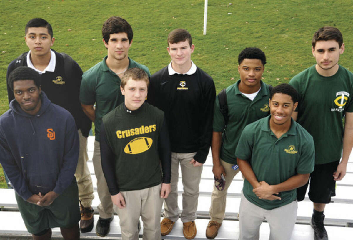 Hour photo/Matthew Vinci Some of the Trinity Catholic High School footabll players who live in the city of Norwalk are Gerardo Gonzalez, Nick Granata, Brian Brown, Courtland Victrum, Maxwell Pagano, Charles Bogus, Wille Sadler, not in the photo is Sean Sullins and Frankie Passerelli.