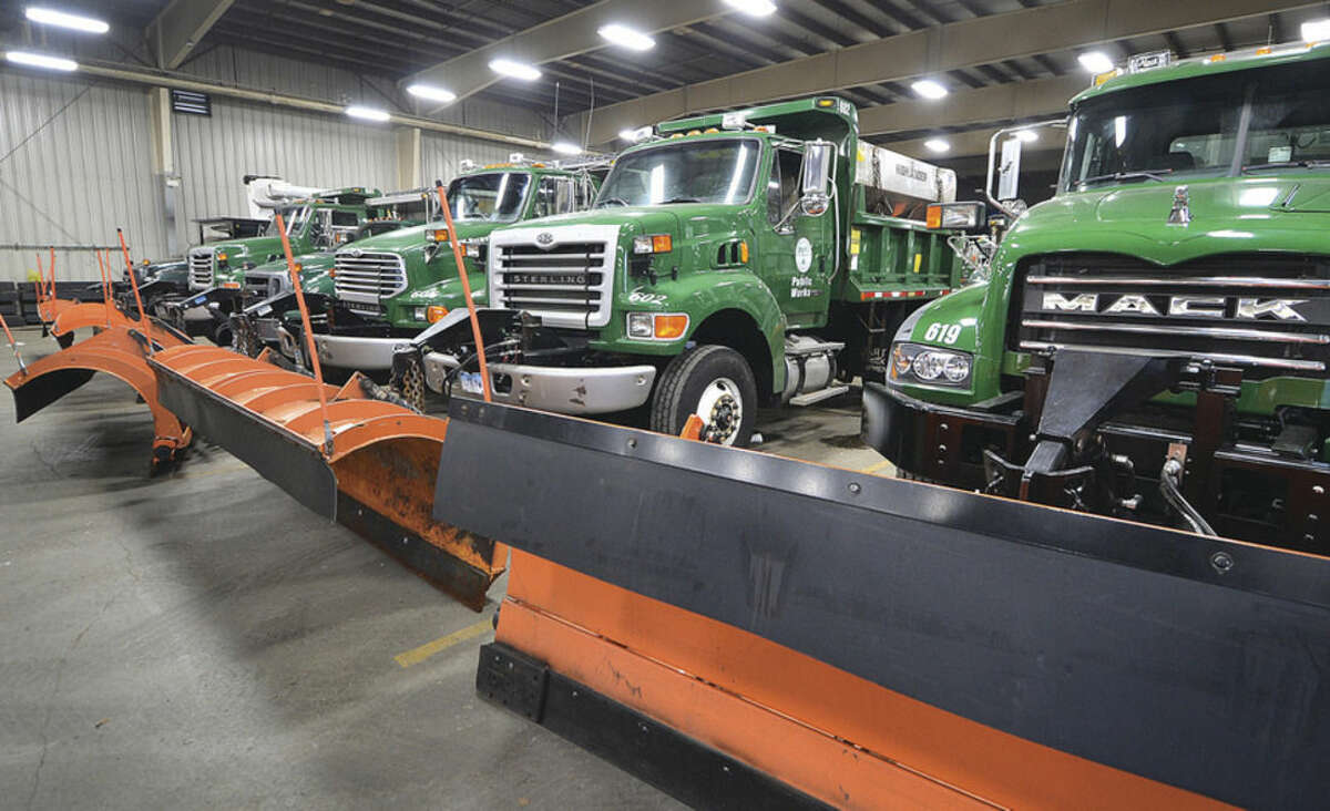 Hour photo/Alex von Kleydorff On Tuesday, the Norwalk Department of Public Works garage had snowplow trucks and other vehicles that could clear snow and treat roads in preparation for a possible snowstorm Wednesday.