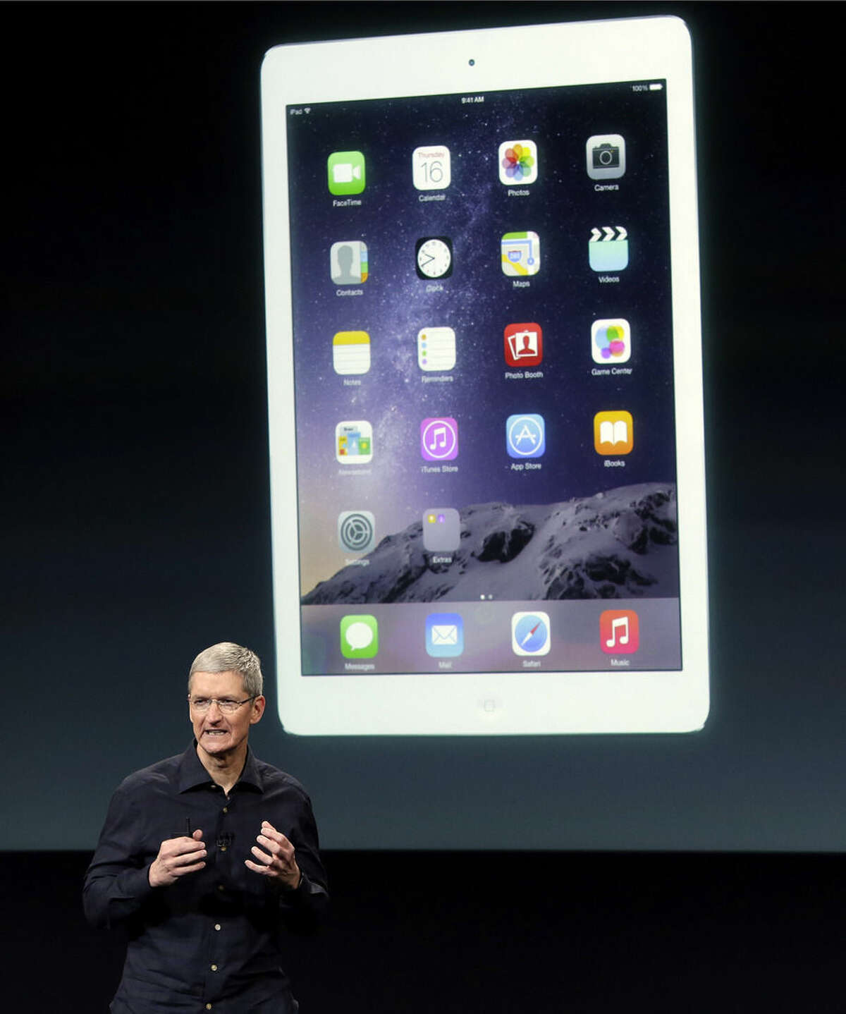 File-This Oct. 16, 2014, file photo shows Apple CEO Tim Cook introducing the new Apple iPad Air 2 during an event at Apple headquarters in Cupertino, Calif. People tend to hold onto tablets longer than smartphones, so take time to weigh your options. A major consideration is what phone you or your gift recipient already has. Although it's possible for Android owners to have Apple's iPads, for instance, there are advantages to sticking within the same system. You often can buy apps just once and share them across both devices, and you don't need to learn two different systems. (AP Photo/Marcio Jose Sanchez, File)